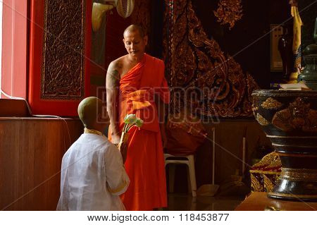 ordination ceremony pay respect to Buddha became Buddhist monk b