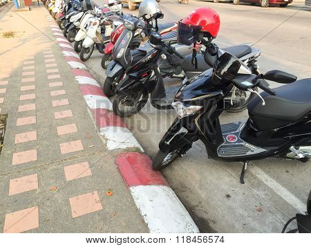 CHIANG RAI THAILAND - FEBRUARY 17 : motorcycles parking on forbidden area on February 17 2016 in Chiang rai Thailand.