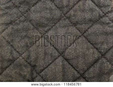 Quilted material texture black and grey close up pattern