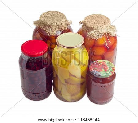 Different Canned Fruits In Glass Jars On A Light Background