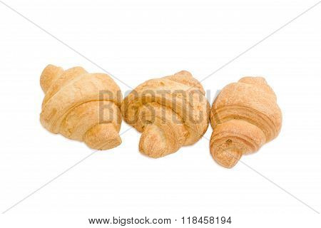 Three Small Croissant On A Light Background