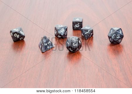 Specialized Polyhedral Dice For Role-playing Games On Wooden Surface