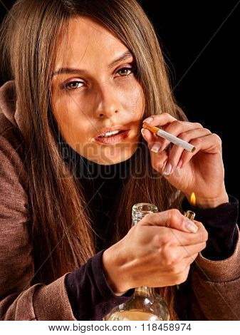 Portrait of young woman looking bad smokes cigarette. Soccial issue smoking.