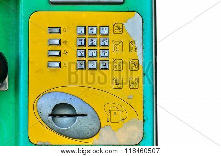 Close up old Buttons street payphone on light morning