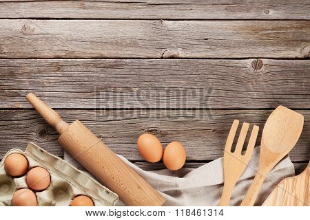 Cooking utensils and ingredients on wooden table. Top view with copy space