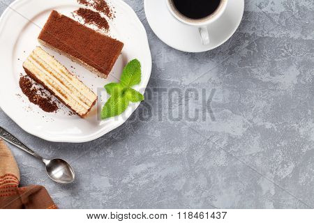 Tiramisu dessert and coffee on stone table. Top view with copy space