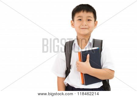 Asian Little School Boy Holding Books With Backpack