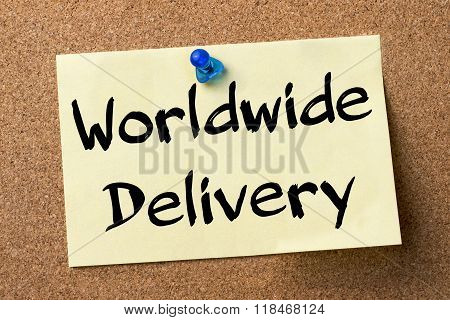 Worldwide Delivery - Adhesive Label Pinned On Bulletin Board