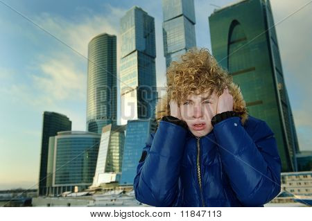 Homeless On The Background Of Modern Buildings