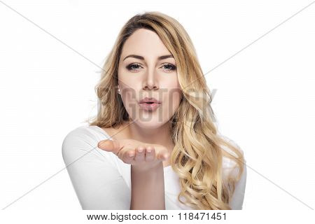 Blonde woman sending air kiss.