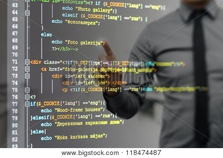 Man Pointing On Virtual Screen With Website Programming Code
