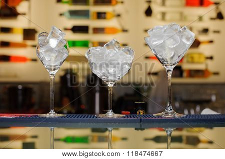 Three Glasses With Ice On The Bar