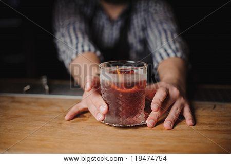 Barman At Work, Serving Cocktails.