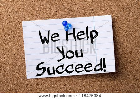 We Help You Succeed! - Teared Note Paper Pinned On Bulletin Board