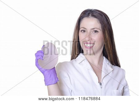 Silicone breast implants. Nurse holding implants. Doctor holding implants. Plastic surgery