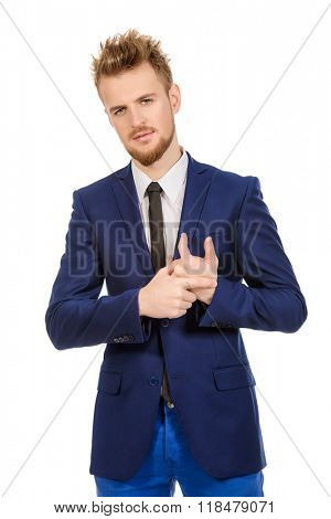 Portrait of a young handsome businessman smiling at camera. Isolated over white.