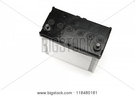 Car battery or automotive battery, isolated on white. Diagonal top view. Rechargeable battery.