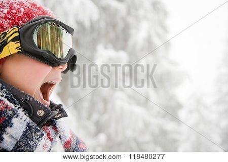 Boy wearing ski goggles