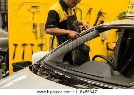 Repairman Is Repairing  Windshield Of The Car