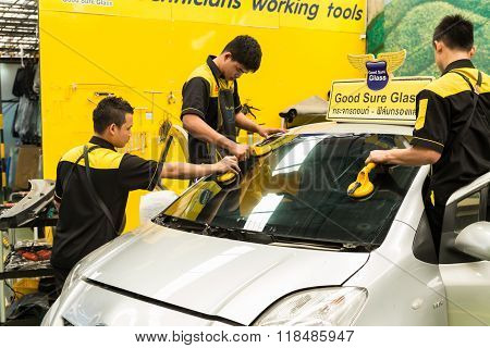 Glazier Is Repairing  Windshield Of The Car