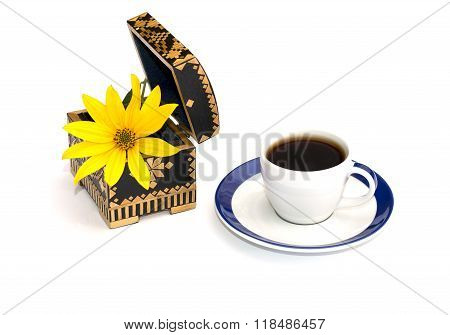 Open Casket And In It A Yellow Flower And Coffee