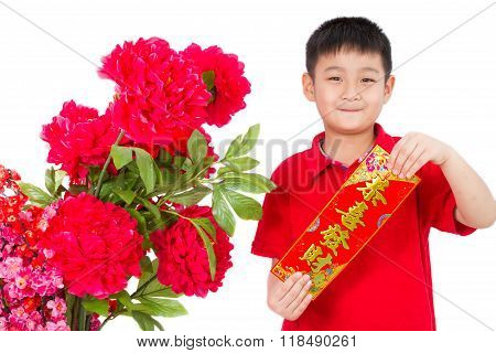 Asian Little Boy Holding Red Couplets For Chinese New Year