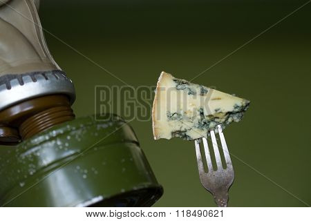 Stinky cheese and man in the gas mask