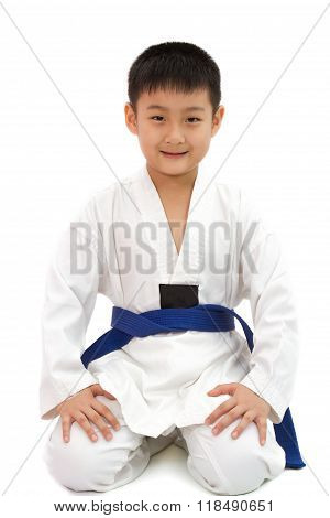 Asian Little Karate Boy In White Kimono