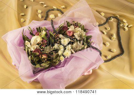 beautiful bouquet of flowers, black pearls on Golden organza