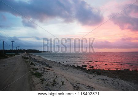 Gravel road between islands evening twilight Haapai Islands Polynesia South Pacific Tonga