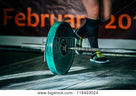 barbel deadlift on a wooden floor