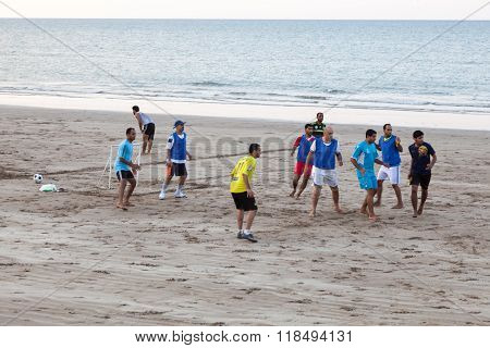 Omani Men Playing Soccer On The Beach In Muscat
