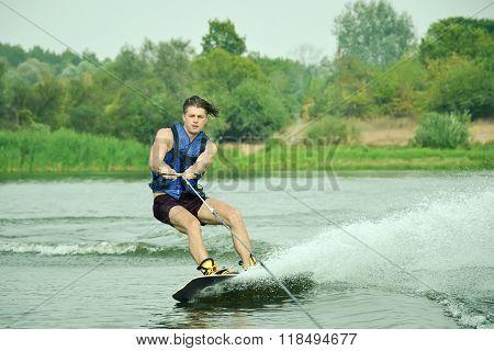 Handsome Man Wakesurfing In A Lake