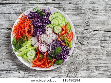 Raw Coleslaw With Red Cabbage, Radish, Cucumber, Sweet Peppers, Carrots, Parsley And Sesame Seeds. H