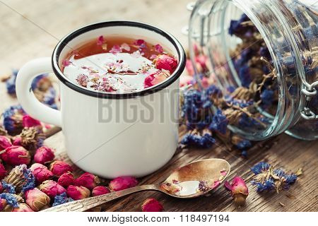 Rose Buds Tea In Tea Cup And Glass Jar Of Forget Me Not Flowers. Retro Toned.