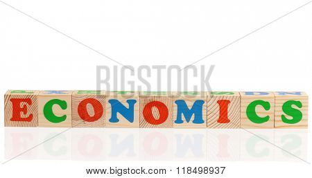 Economics word formed by colorful wooden alphabet blocks, isolated on white background