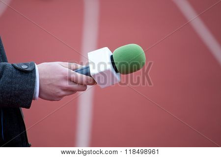 Reporter Holding Microphone For Interview