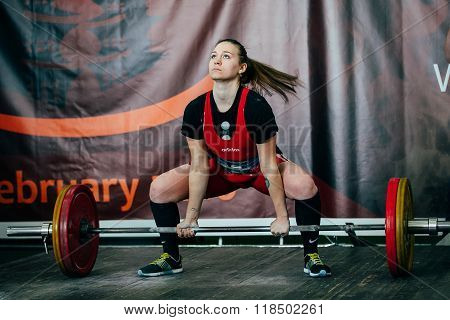 young girl athlete performs deadlift  barbell