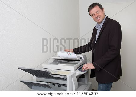 Businessman Who Makes A Photocopy At Work