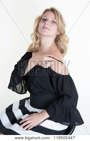 Beautiful Young Blond Woman With Blanck And White Clothes