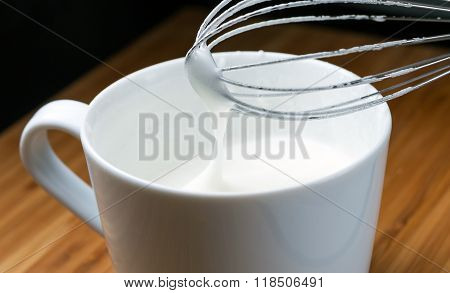 Cup Of Beaten Eggs Whip Cream And Mixer