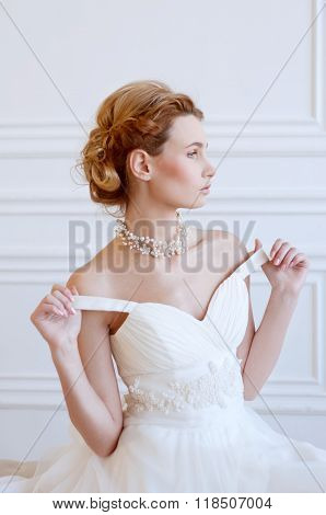 Young Adult Caucasian Blond Bride In White Gown