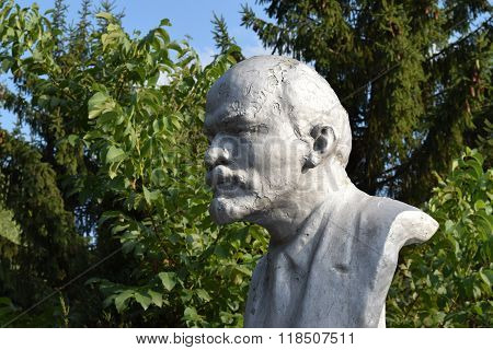 Old monument to Lenin. A concrete bust of Lenin near recreation center in the rural settlement.