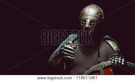 Medieval Knight In The Armor With The Sword And Shield.