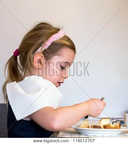 Cute Blond Girl, 4 Years Old, With Pink Hoop In Her Hair  Eating Cake