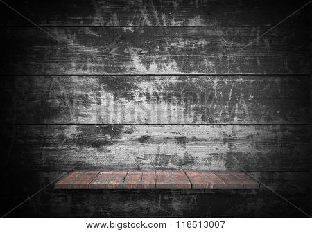 Wooden shelves with wooden background