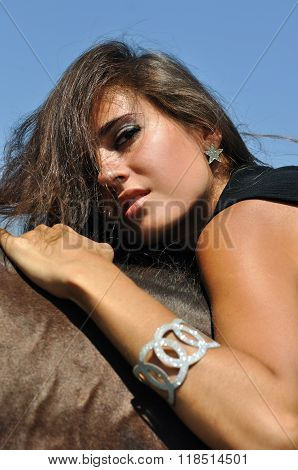 Young Attractive Woman Horseback Riding