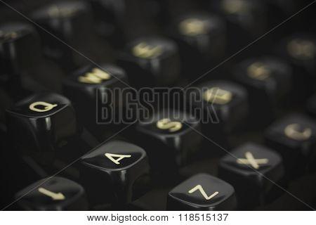 Close Up Of Lettered Keys On An Old Typewriter. Vintage Filter Applied.