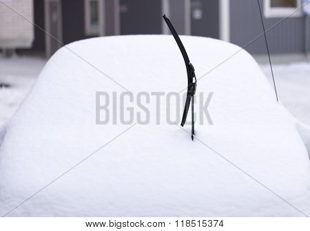 Windscreen Wiper On Snowy Car