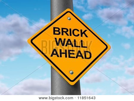 Brick wall ahead road street sign